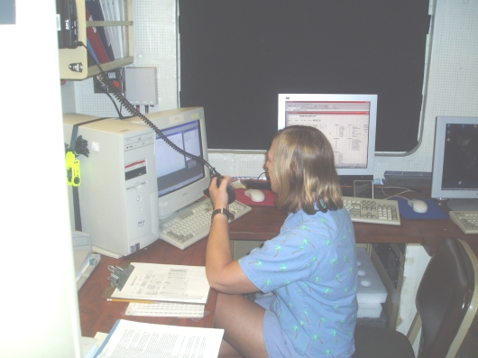 Nancy trains to control the CTD (Conductivity, Temperature, Depth) probe deployment.