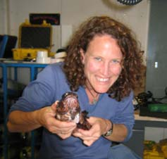 NOAA Teacher at Sea, Tara Treichel, has just taken length and fin ray measurements from this large lionfish, and has removed gonads and a gill sample for lab analysis.