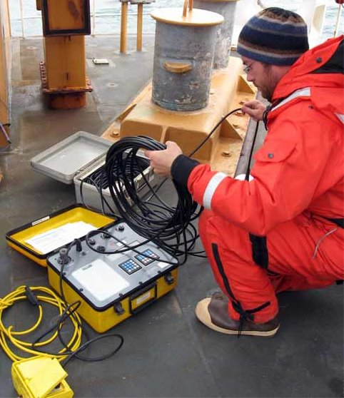 Kevin is setting up the electronics equipment necessary to release the mooring after placement on the sea floor.