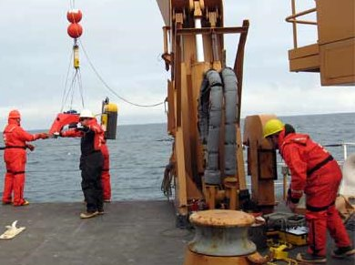 AS the winch raises the instrument array, the scientists and MST team work in tandem to make sure everyone is safe and the deployment successful.