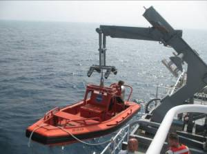 A small boat on the LIBERTY STAR had to be deployed to untwist the ROV cord from the ship's propeller.