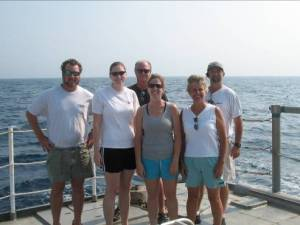 Lynn (right) poses with some fellow crewmembers