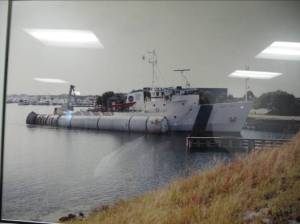 A picture of the LIBERTY STAR with the space shuttle rocket boosters on her starboard side