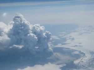 Image of the eruption of Okmok, taken Sunday, July 13, 2008, by flight attendant Kelly Reeves during Alaska Airlines flights 160 and 161.