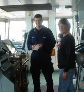 NOAA Teacher at Sea, Katie Turner, gets a tour of the bridge and quick navigation lesson from Ensign Otto Brown