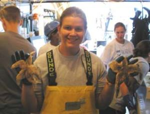 Collecting and sorting the variety of marine life that we find. Here, TAS Risch holds up some sea stars.