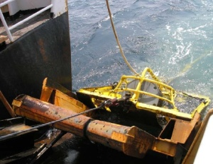 The dredge being brought back up onto the ship after being deployed