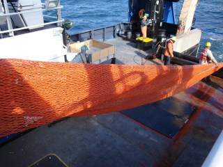 Part of the mid-water trawl net as it's being deployed.