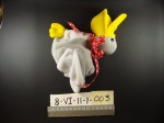 Stuffed toy grey pelican lying on black backgroun with id numbers and ruler below
