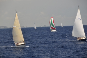 Five sailboats on a blue ocean