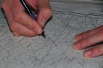 Hands using a compass on a map