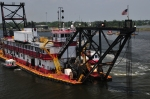 Dredging boat resembles old time riverboat with large paddle wheel