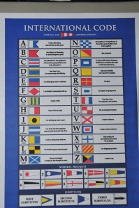 Poster with flags in two vertical columns going 3/4 of way down, and 2 rows of flags across bottom