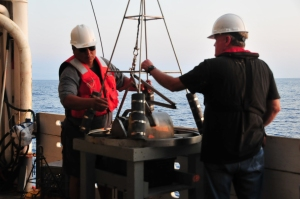 James and Jeff wait for the winch to lift the pyramind-shaped grey grab