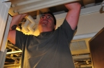 Bob up at the ceiling working with wires