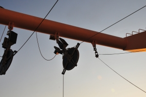 Pulley wheel hanging from an orange support
