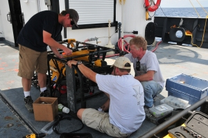 ROV crew working on transferring gear from one ROV to the other on deck