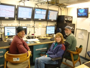 scientists at their desks in the acoustics lab