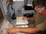 Gene, 1st Assistant Engineer, making conversions on the sounding table