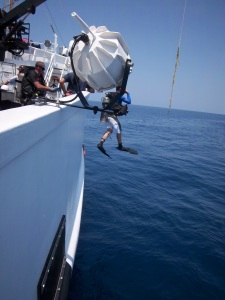 Executive Officer LDCR Jason Appler jumps into the water to perform dive operations