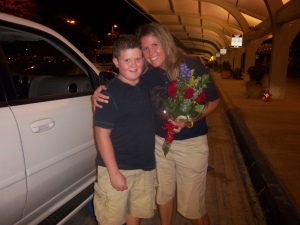My son and Mom surprised me with flowers when they picked me up from the airport!