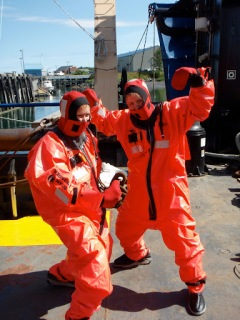 """""""Safety Stand Down Day:"""" Staci and I don orange gumby survival suits... ...and jump off the side of the ship into the water..."""