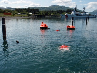 ...then paddle out to life rafts and do relay races to shore with our teammates.