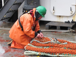 Kerri tying up the trawl net after pulling in a big haul of salmon.