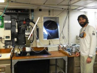 Ludovic Bariteau in front of instrument to measure carbon dioxide fluxes.