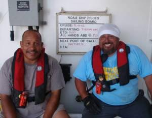 Crewmen Joe Flora and Vic Pinones