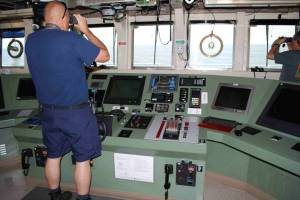 Commander Jeremy Adams looks out from Pisces' bridge Photo credit: Richard Hall