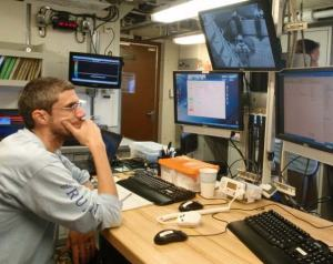 Chief Scientist Nate Bacheler directs trap deployment from the dry lab