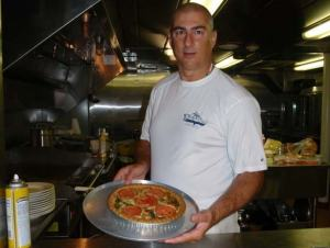 Chief Steward/Chef Jesse Stiggens with a Pisces creation, a vegetable quiche.