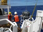 Once the crane operator lifts the unit out of the water, scientists guide the C.D.T. onto the deck.