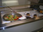 Each nght the steward, cook, prepares a salad bar in the galley.