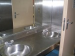 The head in the bunkhouse is equipped with two sinks.