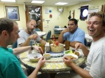 NOAA Scientist Evan Howell, Ryan Nichols, Tafito Aitaoto, Jamie Barlow all enjoy a great Samoan meal in the galley aboard the Sette