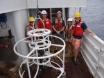 Teacher at Sea, Jennifer Fry, Survey Tech, Scott Allen, and NOAA scientists Evan Howell, Megan Duncan, Aimee Hoover enjoy learning how to safely operate the CTD unit.