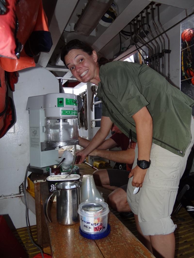 NOAA scientist, Louise Giuseffi shows off Hawaiian shave ice machine aboard NOAA ship Sette.