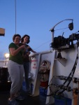 Teacher at sea, Jennifer Fry joins NOAA scientist, Emily Norton longline fishing from the deck of the NOAA ship Sette.