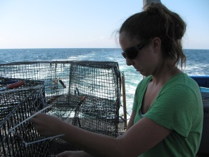 Shelly making modifications to a fish trap