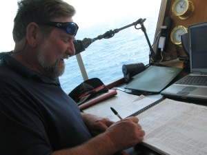 R/V Savannah Captain Raymond Sweatte making a log entry
