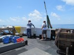 Hauling the trawling net back onboard.