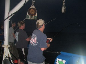 Scientists and boat crew fishing the reef