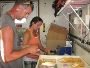 Adam P. and Shelly labeling envelopes and plastic specimen containers