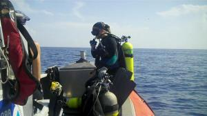 Marine Scientist, Danielle Morley, ready for the signal to dive and retrieve a VR2.