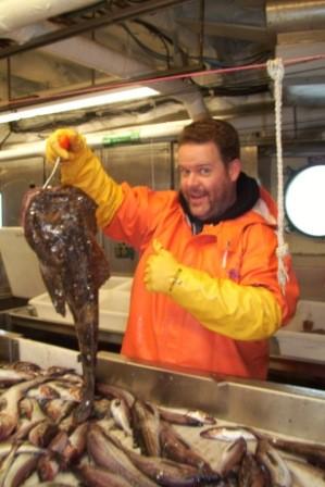Here is fellow TAS (Teacher at Sea) Allan removing a grouper...