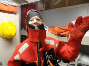 Mrs. Kaiser wearing the survival suit. Photo by Hatsue Bailey.
