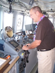 Here I am steering the Oregon II preparing to deploy the high-flier for another longline survey. The Bridge is where the captain conrols the ship. And yes, today is Luau Day!