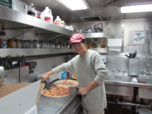 Sherwood Liu of the University of South Florida showed that he can cut pizza with the same good cheer and dedication that he applies to analyzing water samples.